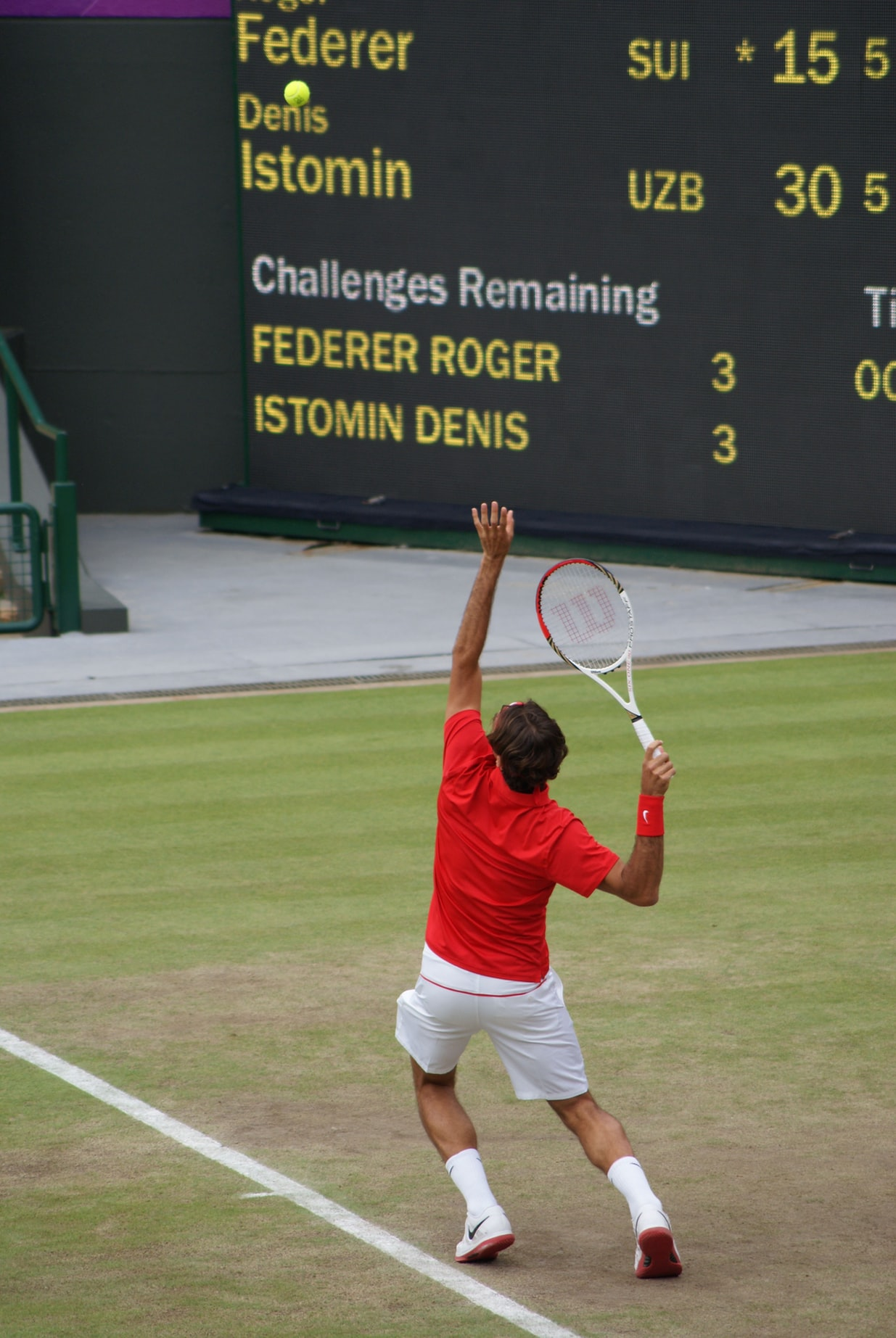 The famous tennis player Roger Federer doing one of his famous serves